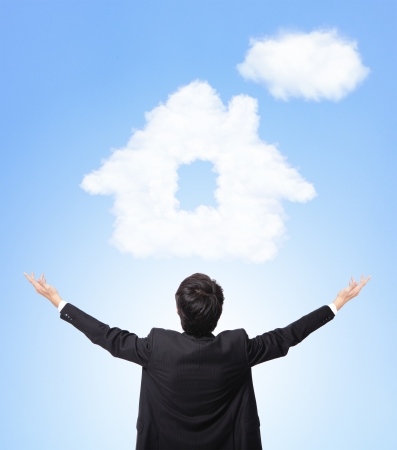 dream home: I want buy a house - back view of business dream a house from clouds on blue sky background, asian model