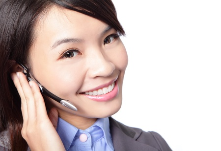 close up of beautiful woman customer support operator with headset and smiling isolated on white background, asian woman Stock Photo - 17495766