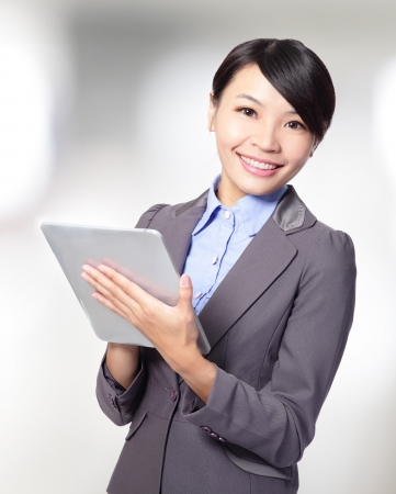 business woman holding a tablet pc at office, asia beauty model photo