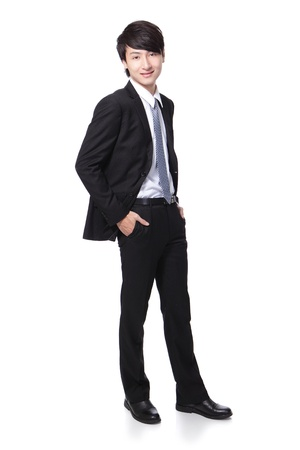 Portrait of a young handsome businessman standing in full body isolated over white background, mode is a asian male photo