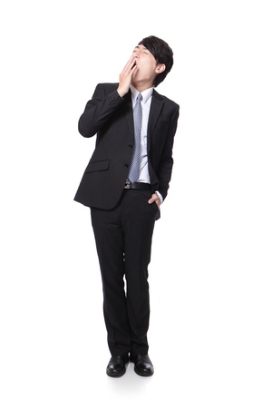 overworked business man yawning in full body isolated on white background, model is a asian people photo