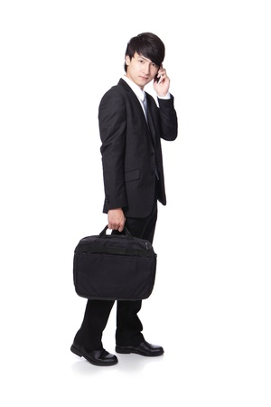 Business man Walking while talking on the mobile phone in full length isolated over white background, asian model photo