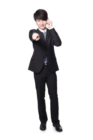 Portrait of handsome young business man using cell phone, pointing to you, isolated on gray background, asian model Stock Photo - 17591649