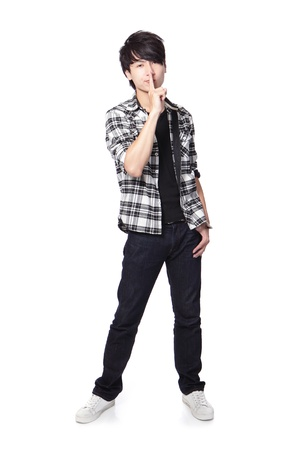 young student man with his finger on his lips asking quiet in full length isolated on white background, asian model Stock Photo - 17592001