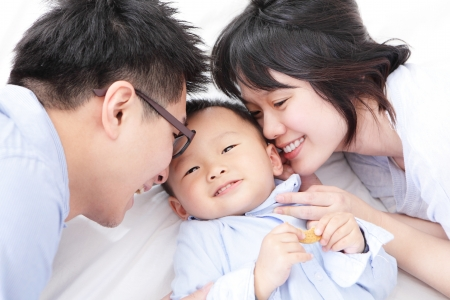 japanese family: Happy family with children in bed, asian people