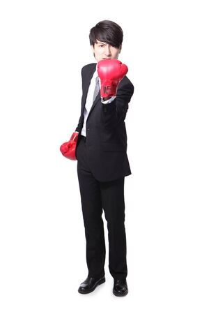 arise: angry businessman  arise arm with boxing gloves in full length isolated over white background, asian modl Stock Photo
