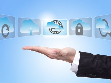 Cloud computing concept , business man hand palm holding all kinds of icon about cloud computing with blue sky background photo