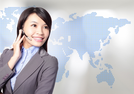 Young business woman operator in headset smile face with asia map background, asian beauty model Stock Photo - 17796090