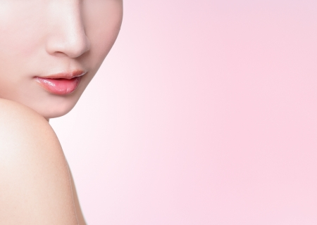 Beautiful female lips closeup with pink background, great for copy space, asian woman model photo