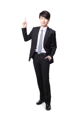 asian businessman standing full length and one finger pointing to up photo