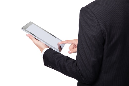 asian businessman using touch pad,a close-up shot on tablet pc, empty screen is great for your design photo