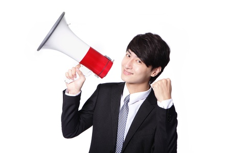asian businessman using bullhorn with energetic face   photo