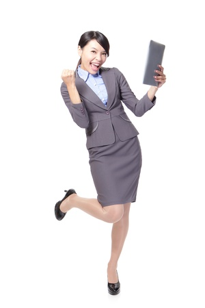 asian businesswoman with touch pad with energetic face,one hand made a fist photo