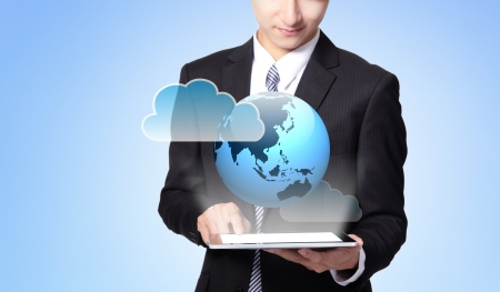 world in your hand - handsome business man using touch screen tablet pc, concept for business and cloud computing, asian man model Stock Photo - 17893401