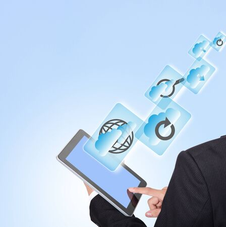 Cloud computing concept , business man touch tablet pc screen with all kinds of icon about cloud computing with blue sky background Stock Photo - 17976199