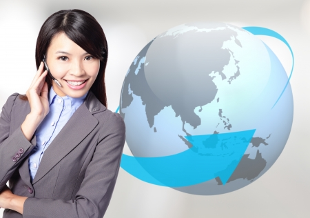 international sales: Young business woman operator in headset smile face with globe background, asian beauty model Stock Photo