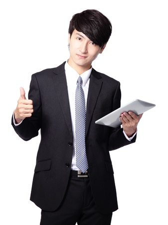 Portrait of young businessman thumb up sign with touch screen computer isolated on white background, asian model photo