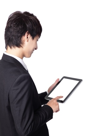 touch pad: asian businessman using tablet pc ,a close-up shot on touch pad, empty screen is great for your design Stock Photo