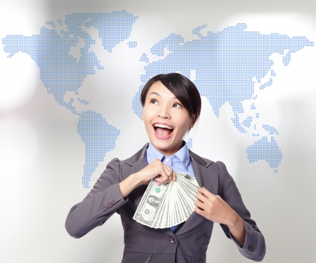 Globe business concept - happy business woman with earned dollar bills us money with world map background, asian beauty model photo