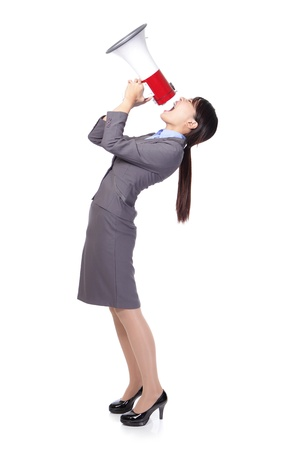 asian businesswoman using megaphone with energetic face photo