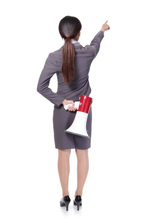 woman shouting: asian businesswoman holding megaphone , back side Stock Photo