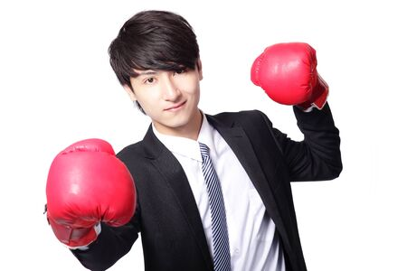 energy work: Asian businessman battle with boxing glove, isolated on white background