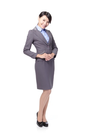 politely: business woman standing and smiling politely, full body,  isolated on white background, asian model