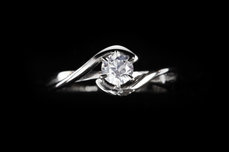 close up of diamond ring with black background photo