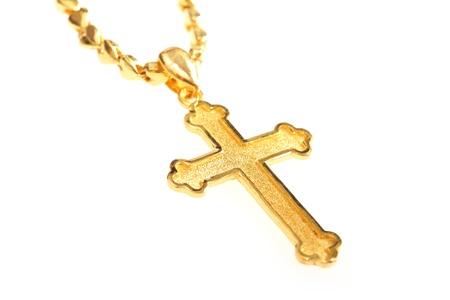 simbolos religiosos: christian dorado cruza con la cadena aislada en el fondo blanco Foto de archivo