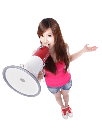 Teenage girl student shouting through megaphone in full length, isolated on white background, high angle view, asian beauty photo