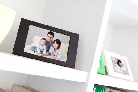 Happy Family photo on white bookshelf at home photo