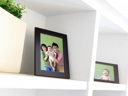 family photo: Happy Family photo on white bookshelf at home Stock Photo