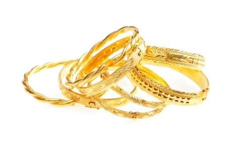 platinum wedding ring: gold jewelry, Golden bracelets , isolated on white background