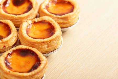 delicious portuguese egg tart with copy space on wooden table photo