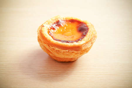 egg tart: delicious portuguese egg tart with copy space on wooden table Stock Photo