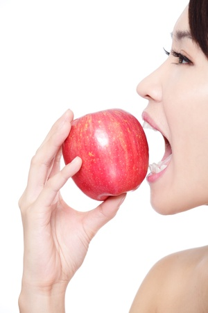 over eating: Beautiful young woman eating red apple with health teeth. Isolated over white background, asian beauty model Stock Photo