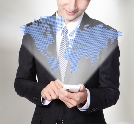 Businessman using smart phone with global map ,asian man photo