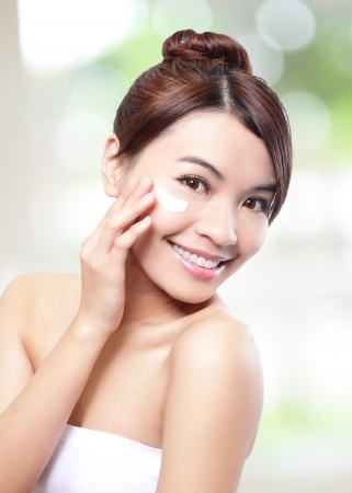 Woman face and apply cream , asian woman photo