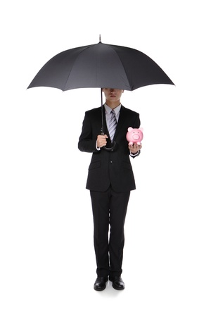 Business Man with an umbrella and piggy bank, concept for  save money, full length, isolated against white background, asian male model photo