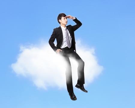 white fly: business man sitting on a cloud and look to empty copy space over blue sky in full length, asian male model