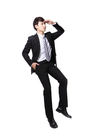 Successful business man sitting on something and look to empty copy space isolated against white background, asian male model Stock Photo - 19264363