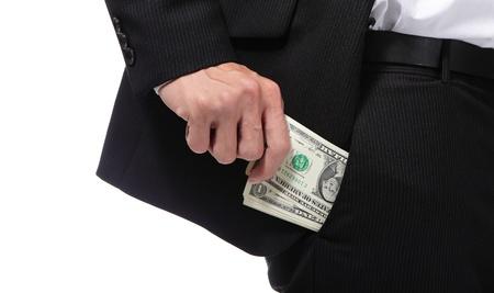 bolsa dinero: El hombre de negocios es poner dinero en el bolsillo. Aislado sobre fondo blanco Foto de archivo