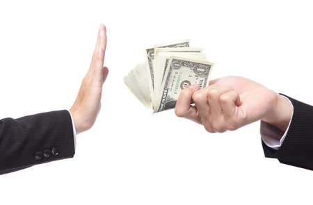 refusing: Business man refusing money offered by business woman isolated on white Stock Photo
