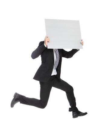 victory sign: business man running jumping and holding whiteboard (billboard) isolated on white background in full length, asian male Stock Photo