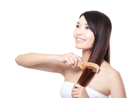 comb: portrait of a beautiful young woman comb wonderful hair isolated on whita background, asian beauty Stock Photo