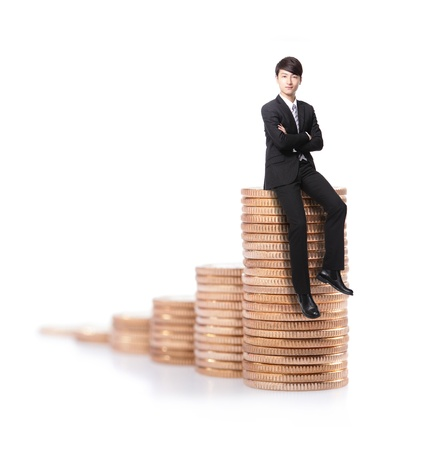Successful business man sitting on money stairs coin and cross arms with smile isolated against white background, asian male model