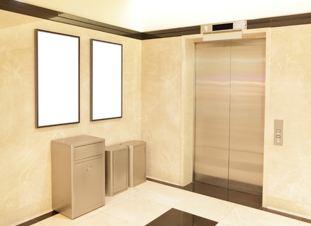 elevator and blank billboard, shot in a shopping mall