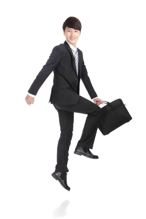 Business man jump and hold briefcase cheerful, asian man photo