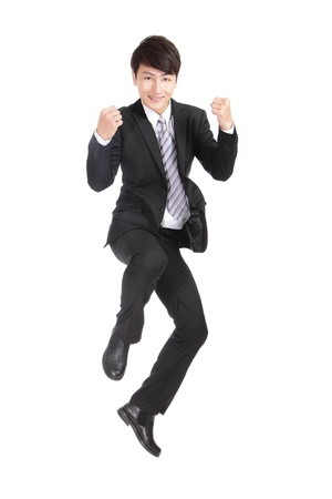 jump suit: Business man jump  cheerful, asian man Stock Photo