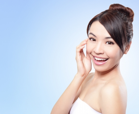 Smile happy Face of beautiful woman with health skin and teeth isolated on blue background. Beautiful young asian woman model